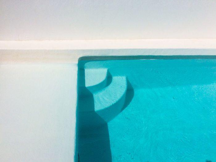 Shadow on swimming pool against sea