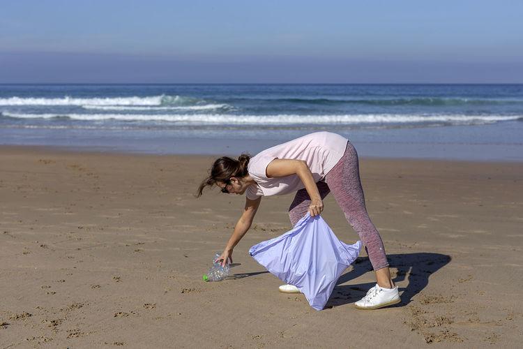 Woman with umbrella on beach