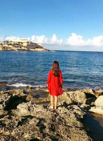 Malta ThatsMe Sea Rear View Water Nature One Person Woman Red Color Dress Sky Beauty In Nature Day Outdoors Sunlight Behind Back Young Woman Standing Beach Horizon Over Water