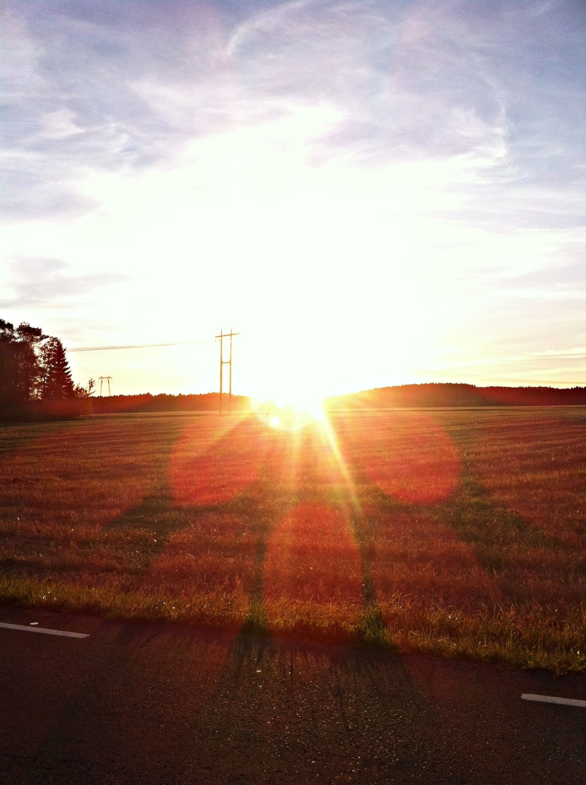 sun, sunset, sunbeam, sunlight, sky, lens flare, landscape, field, tranquil scene, tranquility, scenics, cloud - sky, nature, rural scene, road, beauty in nature, cloud, outdoors, silhouette, grass