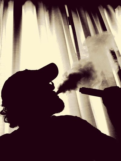 VapeLife VapeDay SteamCorp Enjoying Life Devil's Advocate Day Young Adult Window Shadow Only Men One Person Indoors  One Man Only VapeLife Vapeclouds Vapecommunity