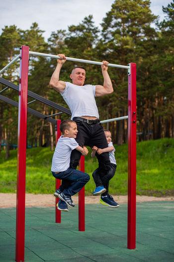 Full length of friends enjoying at playground