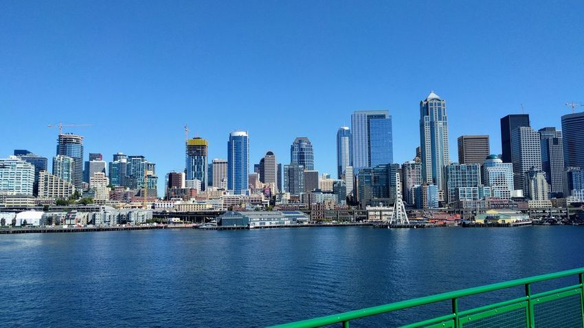 City Urban Skyline Skyscraper No People Architecture Cityscape Clear Sky Water Ferry Ferry Views Ferry Ride Seattle Seattle, Washington Seattle Waterfront Building Exterior Modern Travel Destinations Business Finance And Industry Bridge - Man Made Structure Outdoors Built Structure Office Building Exterior Sky Sea Downtown District