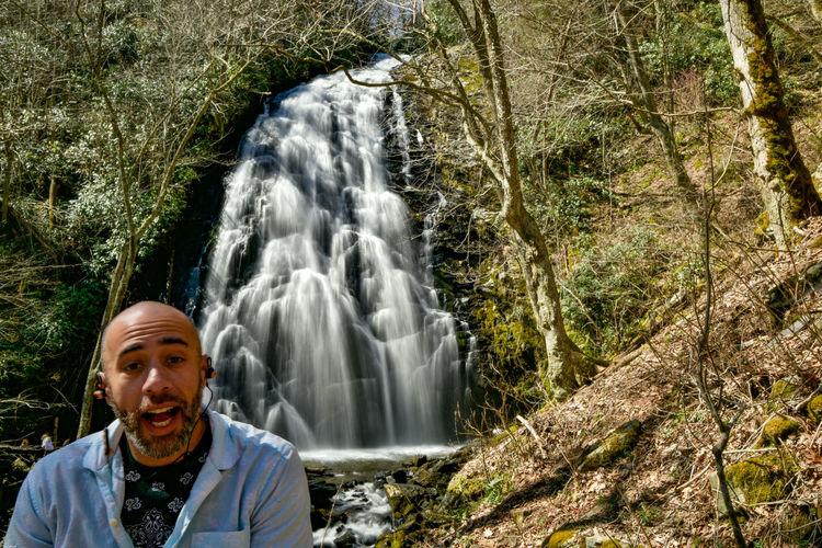 Hiker posing with crabtree falls near little switzerland nc