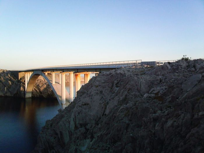 EyeEm Best Shots EyeEm Nature Lover EyeEm Gallery Clear Sky Bridge - Man Made Structure Water Sky Architecture Landscape Built Structure Horizon Over Water Rock Formation Coast Rocky Coastline Calm Rocky Mountains Seascape Sunset Shore