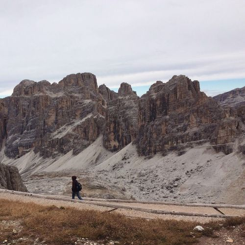 Person Walking On Road Against Dolomites