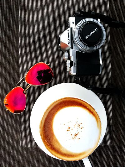 Coffee time and relaxing at coffee shop. Traveling with olympus camera and rayban sun glasses. Latte Mocha Relaxing Traveling Cafe Camera - Photographic Equipment Cappuccino Close-up Coffee - Drink Coffee Cup Directly Above Drink Food And Drink Freshness Froth Art Frothy Drink Hot Coffee Olympus Camera Rayban Refreshment Still Life Sun Glasses Table Top View