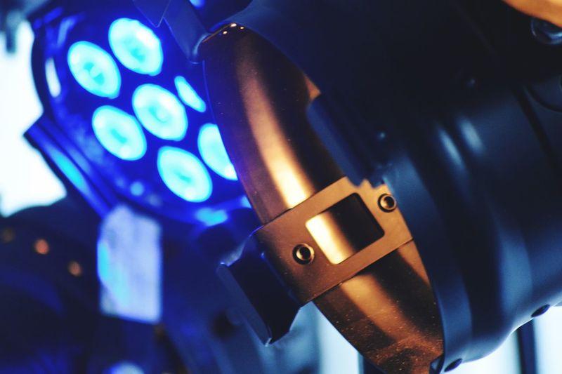 Close-up of illuminated machine part