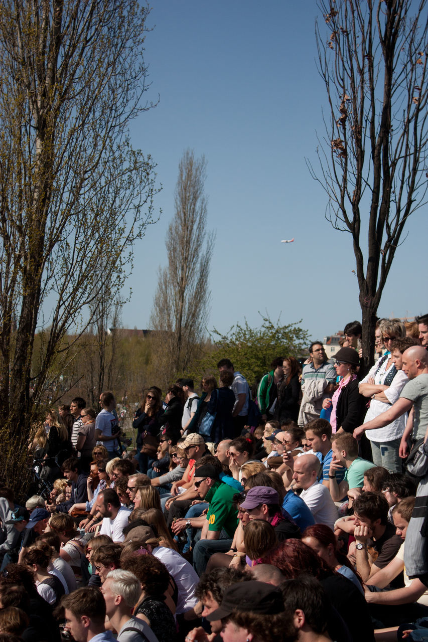 large group of people, crowd, tree, bare tree, real people, outdoors, day, women, men, sky, nature, people