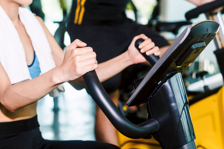 Fitness woman execute exercise with exercise-machine at the gym Adult Close-up Filling Focus On Foreground Fuel Pump Gasoline Hand Holding Human Body Part Human Hand Land Vehicle Lifestyles Midsection Mode Of Transportation Motor Vehicle People Real People Refueling Women