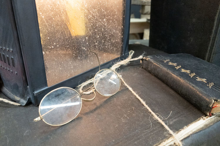 Pastor's old glasses Glasses Bible Vintage Old Religion Spirituality Indoors  No People Metal Glass - Material Close-up Day Water Transparent Still Life Nature High Angle View Sunlight Table Focus On Foreground Household Equipment Steel Preparation  Window