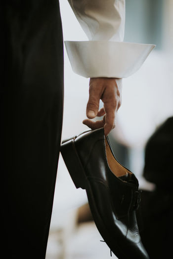 Close-up of hand holding shoe