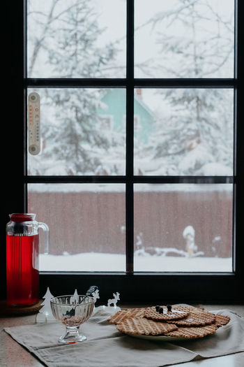 Homemade waffles with jam and a jug with a red drink on the table by the winter window. Homemade Waffle Winter Christmas Decoration Cold Temperature Cup Day Food Food And Drink Freshness Glass Glass - Material Home Interior Indoors  Nature No People Plant Still Life Table Transparent Window