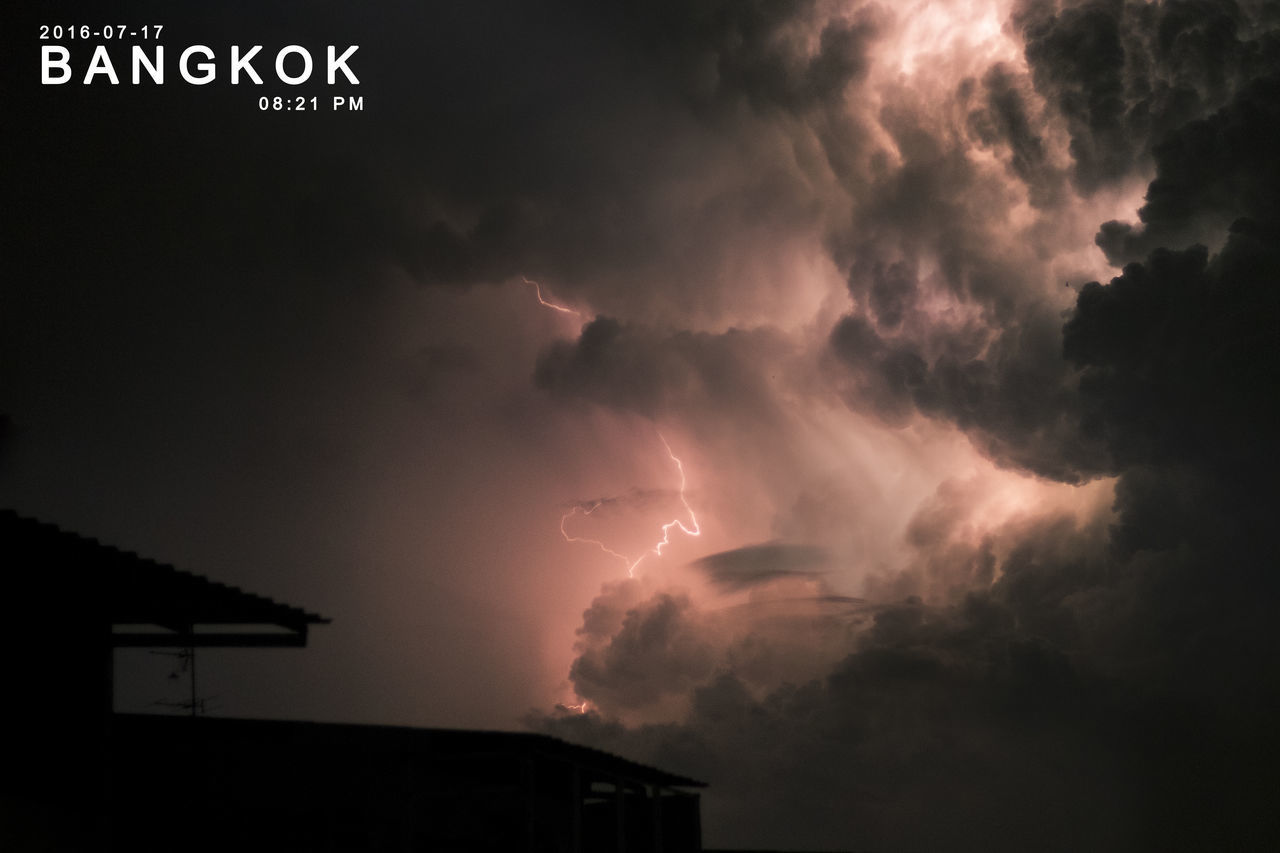 cloud - sky, storm, sky, beauty in nature, architecture, thunderstorm, storm cloud, power in nature, communication, lightning, building exterior, built structure, nature, power, no people, sign, dramatic sky, low angle view, building, outdoors, ominous