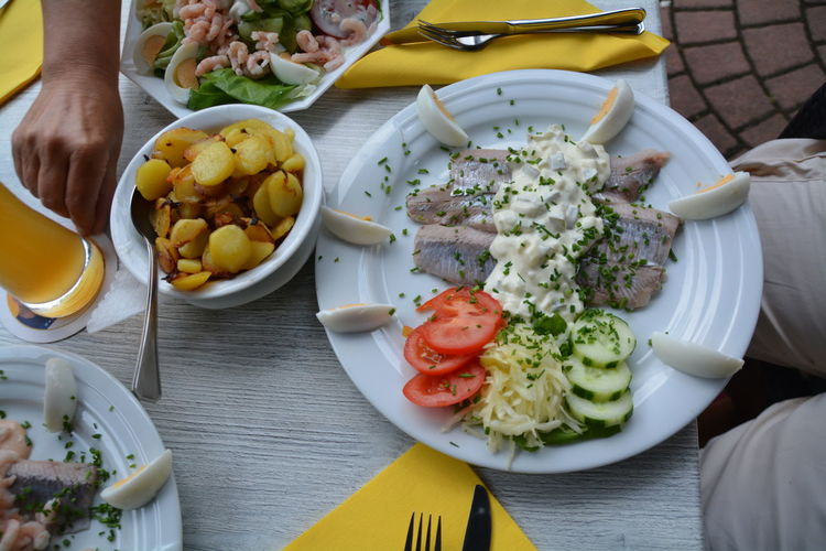 Sea Food With Salad And Prepared Potatoes Served On Table