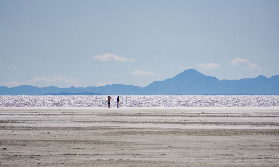 exploring the shore of the Great Salt Lake near Spiral Jetty. Beauty In Nature Coastline Day Great Salt Lake Idyllic Leisure Activity Lifestyles Mountain Nature Non-urban Scene Outdoors Remote Scenics Sea Shore Sky Tourism Tranquil Scene Tranquility Vacations Water Fine Art Photography