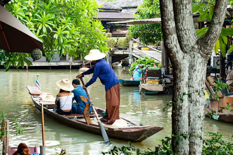 People on boat in river