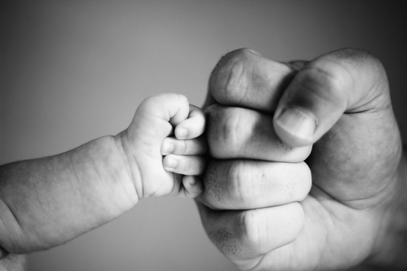 Cropped hands of family giving fist bump