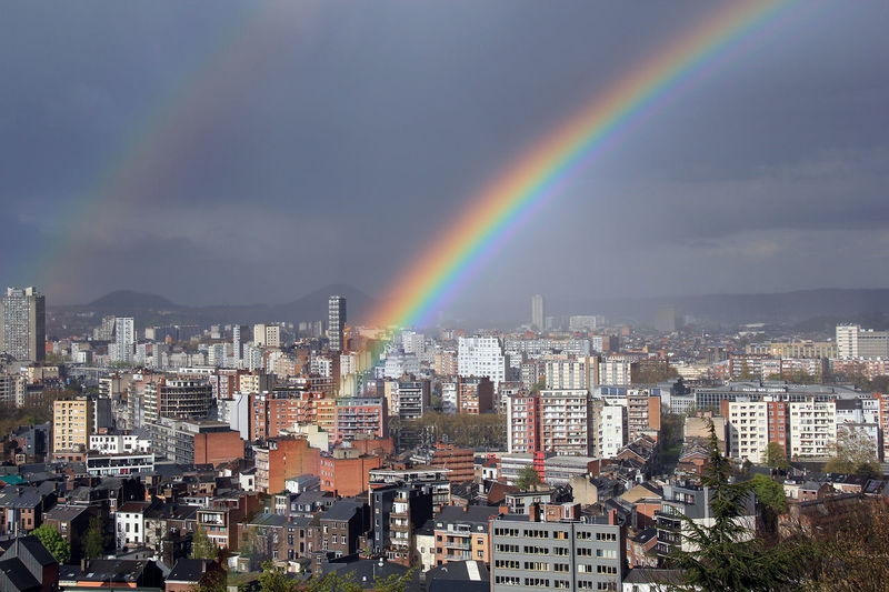 High angle shot of townscape against rainbow