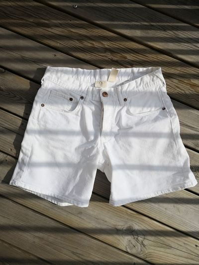 Directly above shot of white hot pants on wooden table