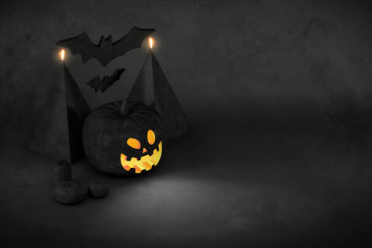 View of illuminated pumpkin against wall at night