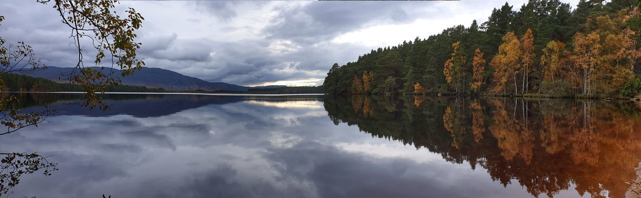 Panoramic view of lake and trees against sky