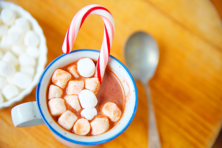 Cup of hot cocoa with candy cane Directly Above No People Sweet Food Close-up Indulgence Temptation Food And Drink Freshness Indoors  Spoon Table Marshmallows Hot Cocoa  Hot Chocolate Christmas Holidays Candy Cane Natural Light Peppermint Point Of View Studio Shot Delicious Mug