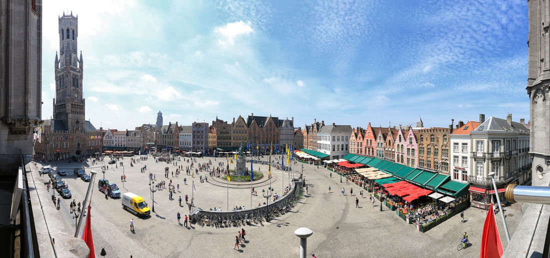 Bruges, Belgium - July 7, 2017: Panoramic view of the market square in the center of Bruges, Flanders. Beer Belgium Brugge Chocolate Dijver Canal Duvel Flanders Panoramic View Provinciaal Hof West Flanders Aerial View Belfry Tower Bikes Bruges Europe Flower French Fries Holland Market Square Medieval Town Mussels