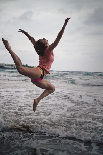 Beach Beauty In Nature Cloud - Sky Day Energetic Full Length Horizon Over Water Jumping Leisure Activity Lifestyles Mid-air Motion Nature One Person Outdoors People Real People Sea Sky Water Young Adult
