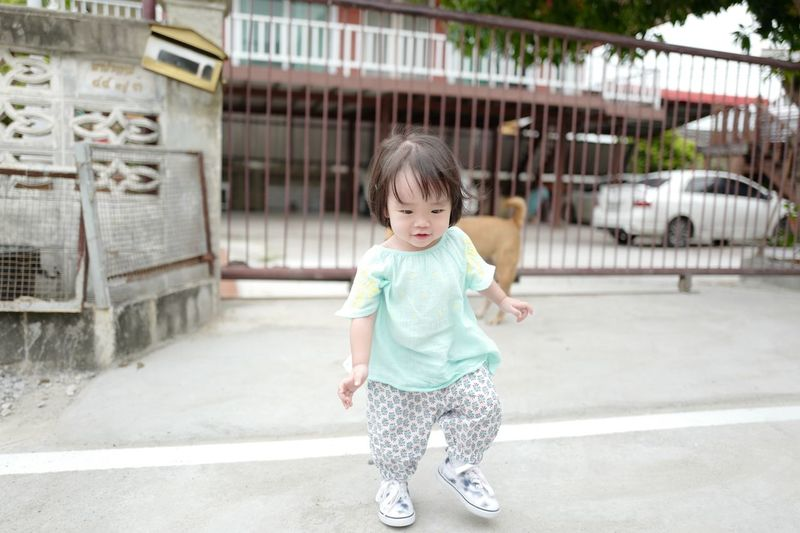 Childhood Child Full Length Real People Innocence One Person Front View Portrait Babyhood Smiling Young Architecture Females Cute Casual Clothing Hairstyle Baby Day Looking Outdoors