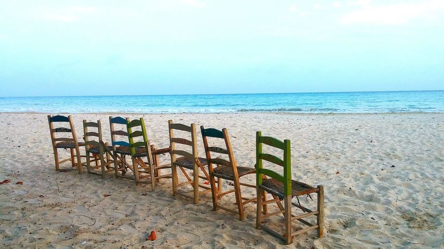 Sea Horizon Over Water Beach Water Sand Shore In A Row Scenics Tranquil Scene Tranquility Beauty In Nature Sky Nature Outdoors Seascape Calm Breakwater Coastline chairs woodenchairs blue bleu chaises plage nature mer sea bluesky Haïti Ayiti Eyeem Market Eyemphotography