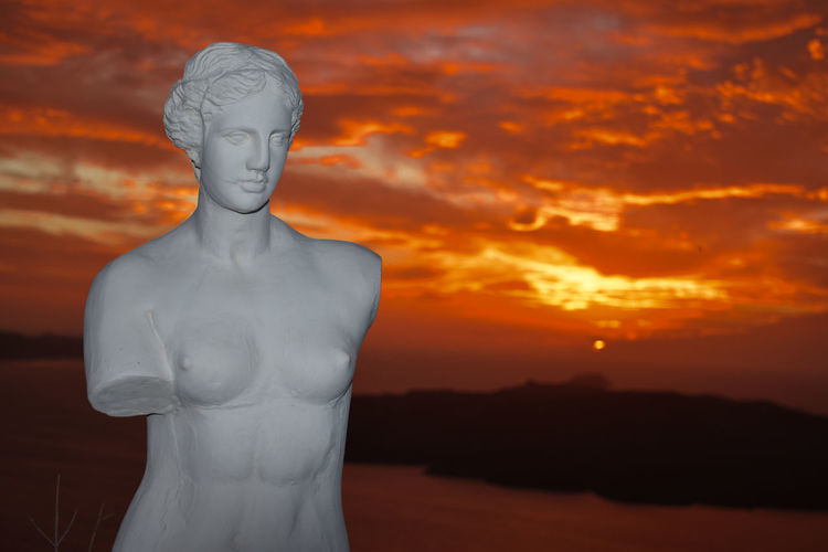Close-up of statue against sky during sunset
