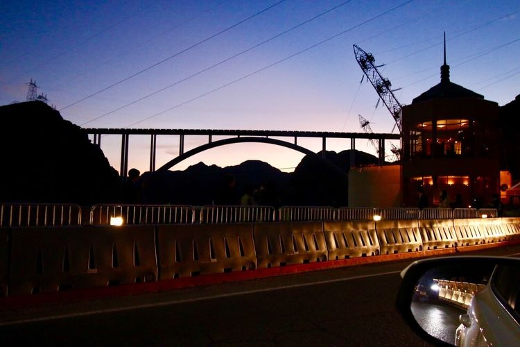 On the Hoover Dam bridge at night Built Structure Bridge - Man Made Structure Architecture Transportation Sunset Connection Sky Land Vehicle Water Illuminated Night No People Outdoors Building Exterior Bridge River Road Clear Sky Cable