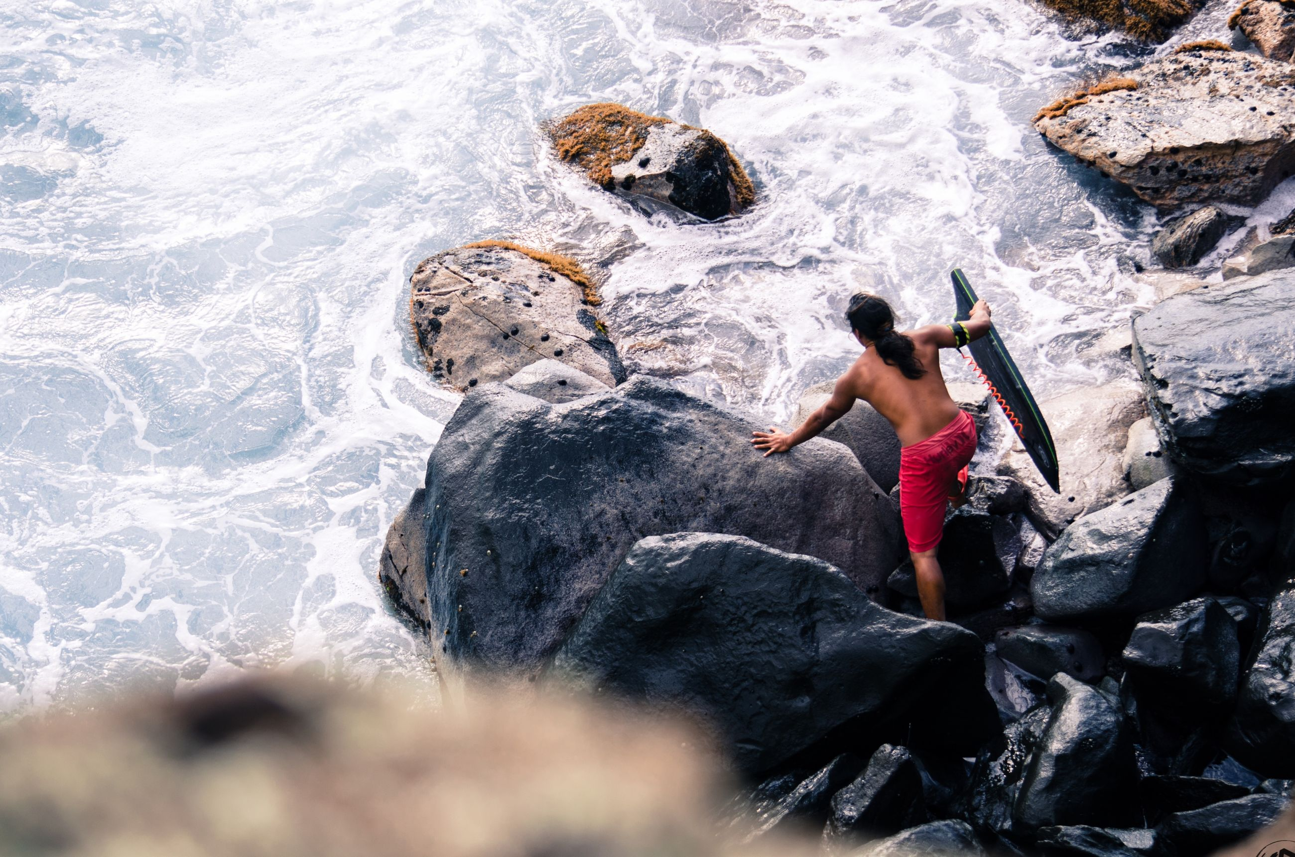 water, lifestyles, leisure activity, full length, rock - object, high angle view, person, childhood, shirtless, vacations, casual clothing, motion, elementary age, beach, boys, surf, day, nature