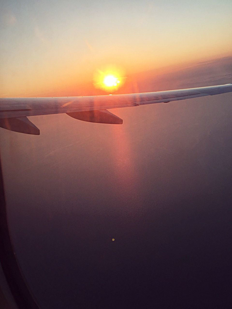 airplane, journey, transportation, sunset, airplane wing, mode of transport, nature, air vehicle, sun, scenics, travel, no people, beauty in nature, sky, aerial view, tranquil scene, tranquility, aircraft wing, outdoors, flying, landscape, water, sea, vehicle part, close-up, day