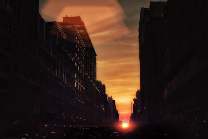 Manhattan Henge, 23rd street. Streetphotography New York City Sunset
