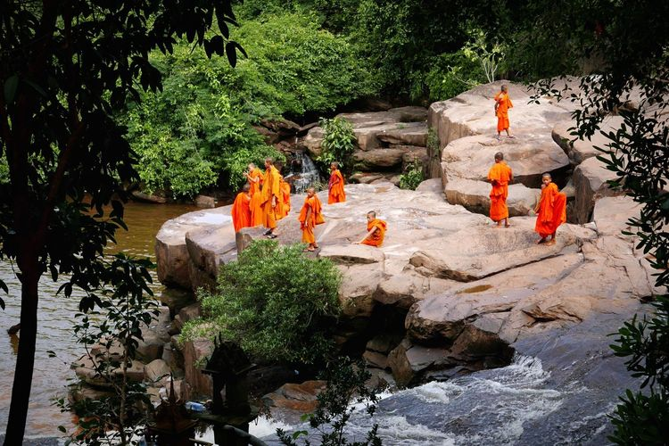 Monks have some leisure days too ! :) Monks Monk  Khmer Cambodia Cambodian ASIA Culture Leisure Activity Leisure Waterfall Waterfalls Jungle Nature Kid Kids Young Swimming Water Rocks Natural Hanging Out Sunny Day Summer People Together This Is Family Focus On The Story