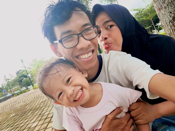 Portrait of happy family at park