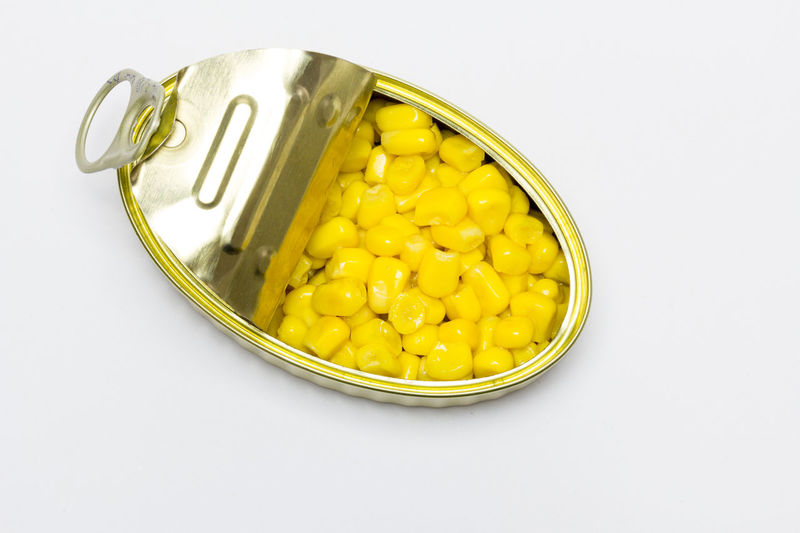 High angle view of yellow eggs on white background