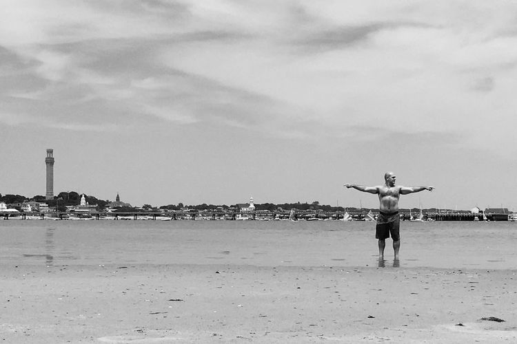 Man On A Beach Tidal Basin Tidal Wetlands Summertime Summer Sky Sand Beach Arms Raised Standing Day Cloud - Sky Outdoors Full Length Man Sea Beauty In Nature Man Cape Cod Massachussets Provincetown Cape Cod This Is Masculinity