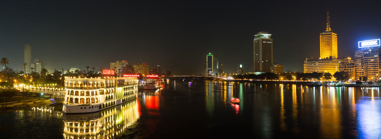 Central Cairo at night, the Island of Zamalek and the famous restaurants on the Nile river. Africa Architecture Boat Building Exterior Cairo City City City Life Cityscape Egypt Illuminated Near East Night Nile River North Africa Reflection Restaurant River Tower Travel Destinations Urban Skyline Water Waterfront Zamalek EyeEmNewHere EyeEmNewHere