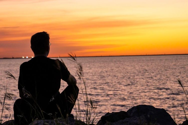 Thinking 🤔 Sunset Sky Sea Rear View Water One Person Lifestyles Beauty In Nature Real People Orange Color Nature Horizon Over Water Leisure Activity Men Scenics - Nature Sitting Land Horizon Outdoors