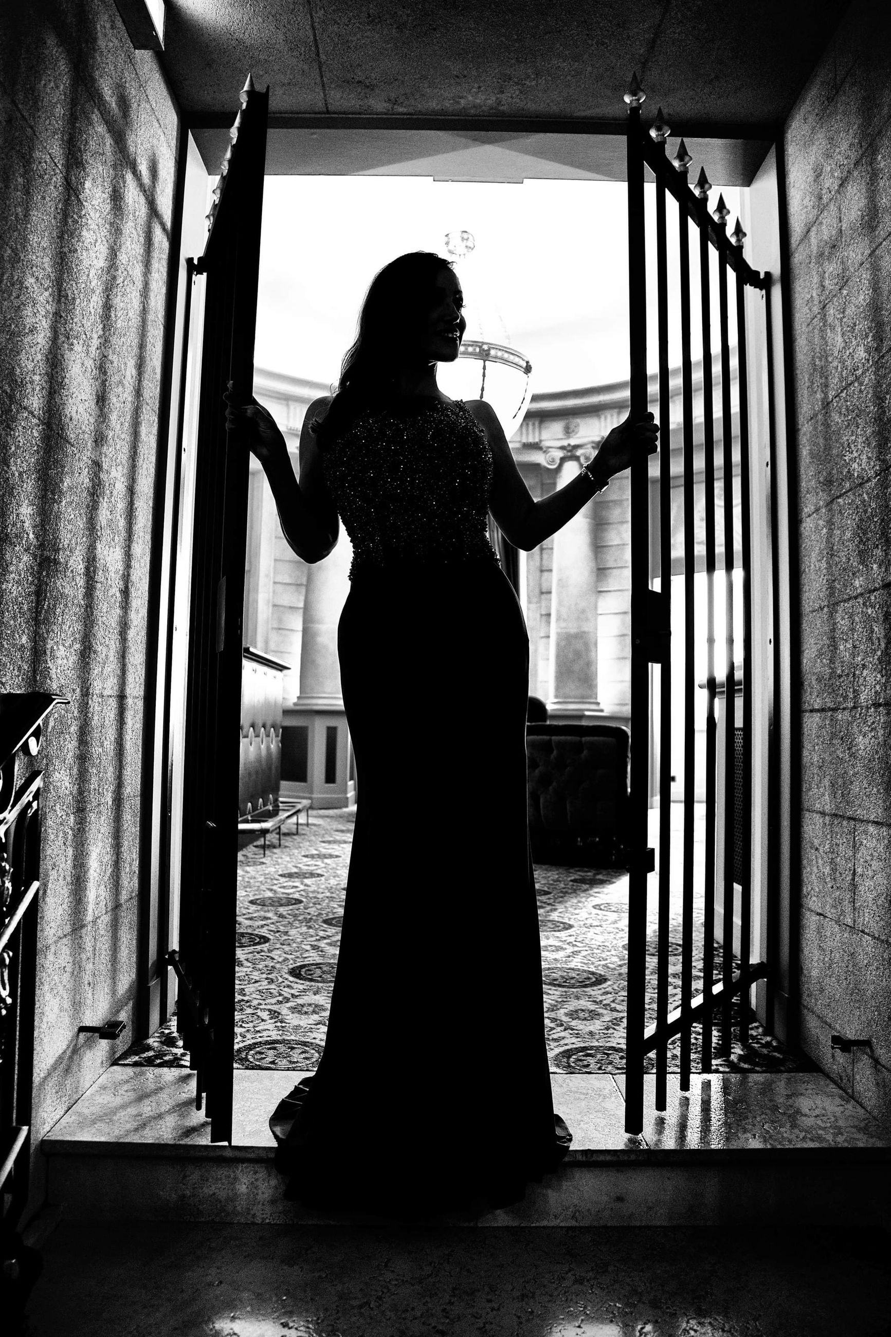black, black and white, white, one person, monochrome, monochrome photography, adult, women, indoors, bride, standing, full length, architecture, silhouette, lifestyles, darkness, person, wedding dress, female, young adult, dress