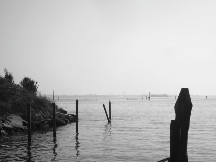 🇮🇹 Blackandwhite Bnw_friday_eyeemchallenge Copy Space Clear Sky Sea Water Tranquility Wooden Post Poles Waterfront Seascape Venezia Fusina TakeoverContrast Tranquil Scene Bnw Black & White Bnw_landscapes Monochrome Photography Melancholic Landscapes