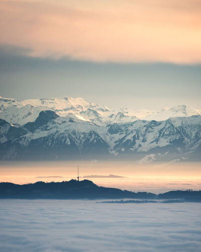 Scenics - Nature Beauty In Nature Sky Mountain Sunset Tranquil Scene Tranquility Water Cloud - Sky Mountain Range Nature Idyllic Cold Temperature Sea No People Orange Color Winter Snow Snowcapped Mountain Outdoors Fog Clouds Sea Of ​​clouds Switzerland Bantiger
