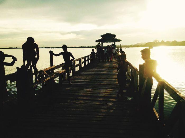 EyeEmNewHere Sky Water Real People Railing Group Of People Nature Pier