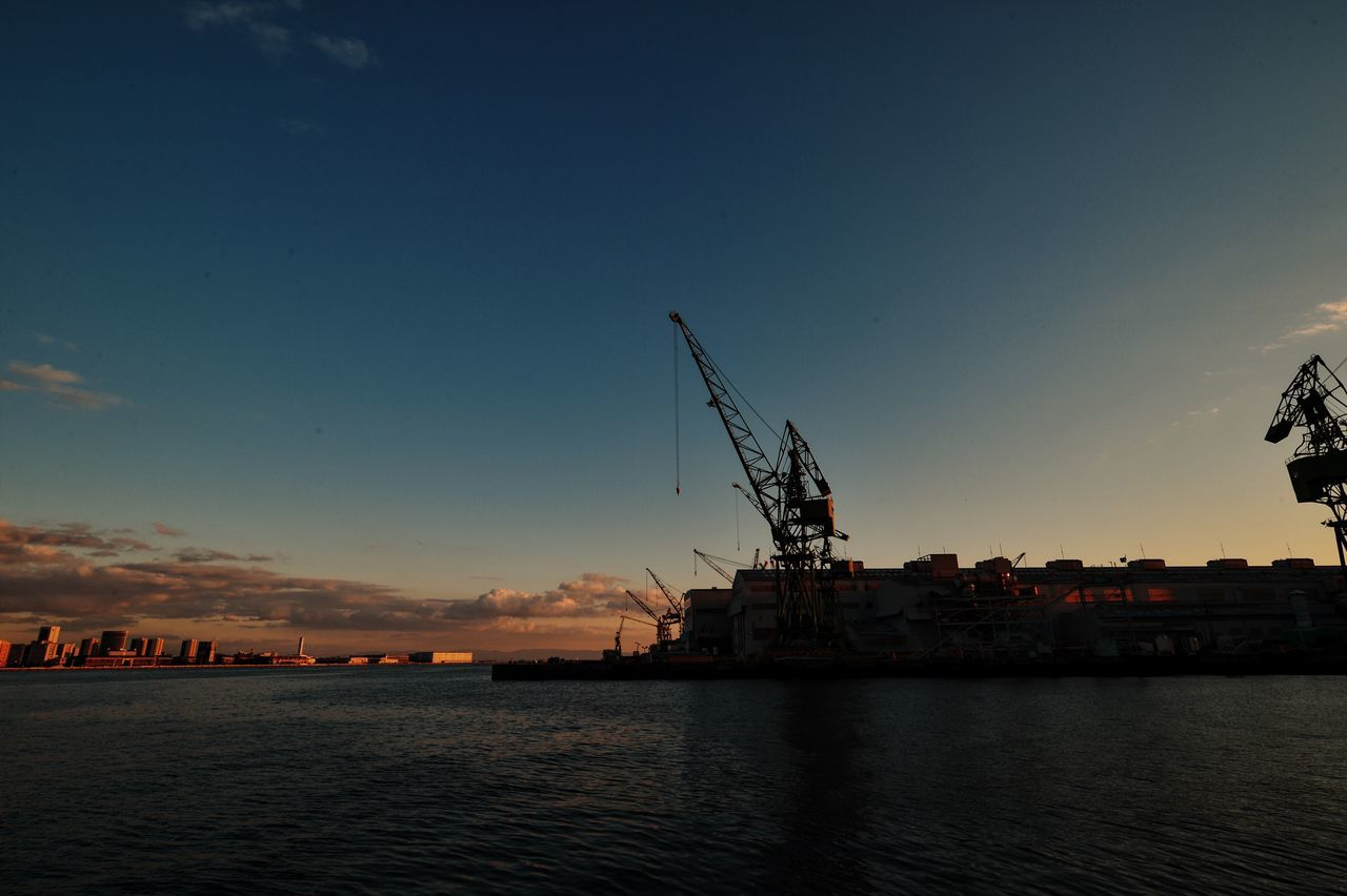 sunset, water, sky, crane - construction machinery, sea, waterfront, no people, harbor, commercial dock, crane, built structure, industry, freight transportation, outdoors, nature, building exterior, nautical vessel, scenics, architecture, beauty in nature, offshore platform, cityscape, city, drilling rig, day