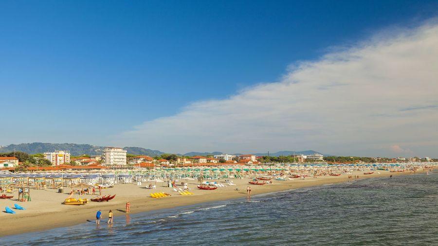 Beach against sky at town