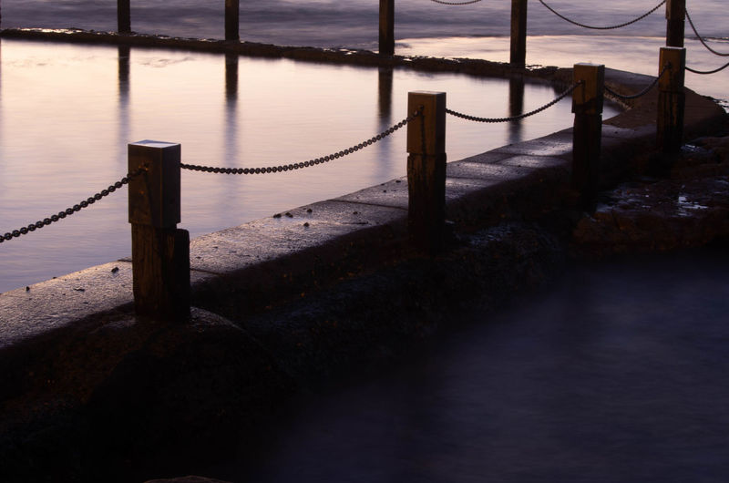 Beauty In Nature Boundary Day Fence High Angle View Metal Nature No People Outdoors Pier Post Railing Rope Safety Sea Tranquil Scene Tranquility Water Wooden Post
