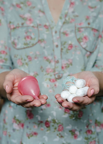 Midsection of woman holding equipment